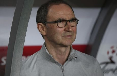Republic of Ireland manager Martin O'Neill watches the game during an international friendly soccer match between Turkey and Republic of Ireland in Antalya, Turkey, Friday, March 23, 2018. (AP Photo)