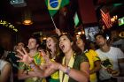 NEW YORK, NY - JUNE 12:  Angela Stewart (C), a Brazilian soccer fan originally from Rio de Janeiro, Brazil,  waits with bated breath while watching the Brazil vs. Croatia World Cup game at Legends Bar on June 12, 2014 in New York City. Brazil vs Croatia is the first game of the World Cup, which will take place throughout Brazil until Sunday, July 13.  (Photo by Andrew Burton/Getty Images)
