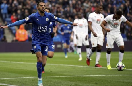 Leicester City's Riyad Mahrez celebrates scoring his side's second goal of the game during the English Premier League soccer match Leicester City against Watford at the King Power Stadium, Leicester, England, Saturday May 6, 2017. (Nick Potts/PA via AP)