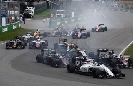 Circuit Gilles Villeneuve, Montreal, Canada. Sunday 12 June 2016. Felipe Massa, Williams FW38 Mercedes, leads Fernando Alonso, McLaren MP4-31 Honda, Jenson Button, McLaren MP4-31 Honda, Sergio Perez, Force India VJM09 Mercedes, and the remainder of the field at the start. Photo: Glenn Dunbar/Williams ref: Digital Image _V2I4661