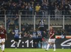 Inter Milan's Mauro Icardi top, celebrates after scoring during the Serie A soccer match between Inter Milan and AC Milan, at the Milan San Siro Stadium, Italy, Sunday, Oct. 15, 2017. (AP Photo/Antonio Calanni)