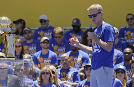 Golden State Warriors coach Steve Kerr speaks during the NBA basketball team's championship rally Thursday, June 15, 2017, in Oakland, Calif. Oakland is celebrating its second championship in the past three years. (AP Photo/Eric Risberg)