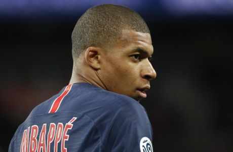 PSG's Kylian Mbappe looks at his teammates during the League One soccer match between Paris Saint-Germain and Stade Rennais at the Parc des Princes stadium in Paris, Saturday May 12, 2018. (AP Photo/Christophe Ena)