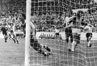 FILE - In this June 16, 1982 file photo, Algeria's Lakhdar Belloumi, left, celebrates after scoring the second and winning goal for his team during the World Cup soccer match between Algeria and West Germany in Gijon, Spain. (AP Photo/File)