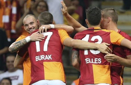Galatasaray's Wesley Sneijder, left, of the Netherlands, celebrates his goal against Inter Milan with his teammates during their pre-season friendly soccer match at Turk Telekom Arena in Istanbul, Sunday, Aug. 2, 2015. Galatasaray won the match 1-0. (AP Photo)