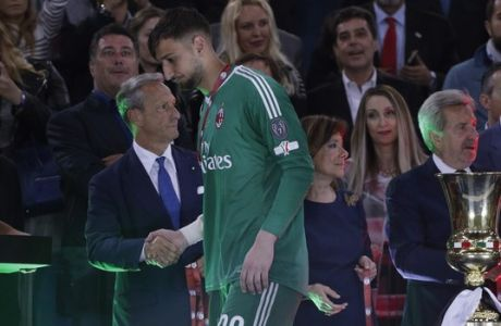 AC Milan goalkeeper Gianluigi Donnarumma walks past the trophy after the Italian Cup final soccer match between Juventus and AC Milan, at the Rome Olympic stadium, Wednesday, May 9, 2018. (AP Photo/Gregorio Borgia)