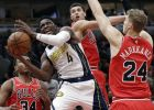 Indiana Pacers guard Victor Oladipo (4) drives to the basket against Chicago Bulls center Wendell Carter Jr., left, guard Zach LaVine, center, and guard Lauri Markkanen during the first half of an NBA basketball game Friday, Jan. 4, 2019, in Chicago. (AP Photo/Nam Y. Huh)