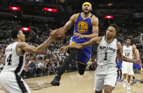 Golden State Warriors center JaVale McGee (1) drives between San Antonio Spurs forward Danny Green (14) and San Antonio Spurs guard Kyle Anderson (1) during the first half in Game 3 of the NBA basketball Western Conference finals on Saturday, May 20, 2017, in San Antonio. (AP Photo/Ronald Cortes)