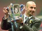 Chelsea's player and manager Gianluca Vialli celebrates with the Coca-Cola Cup trophy after his Chelsea team beat Middlebrough 2-0 in the final at London's Wembley stadium Sunday March 29, 1998. (AP Photo/Max Nash)