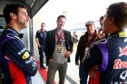 AUSTIN, TX - NOVEMBER 01:  Actor Keanu Reeves speaks with Sebastian Vettel of Germany and Infiniti Red Bull Racing and Daniel Ricciardo of Australia and Infiniti Red Bull Racing in the team garage after final practice for the United States Formula One Grand Prix at Circuit of The Americas on November 1, 2014 in Austin, United States.  (Photo by Mark Thompson/Getty Images) *** Local Caption *** Sebastian Vettel;Daniel Ricciardo;Keanu Reeves