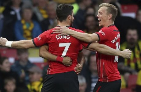 Southampton's Shane Long celebrates scoring his side's first goal of the game against Watford, during their English Premier League soccer match at Vicarage Road in Watford, London, England, Tuesday April 23, 2019. (Adam Davy/PA via AP)