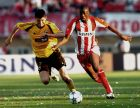 Olympiacos' Yaya Toure from Ivory Coast, right, challenges for the ball with AEK's Vladan Ivic from Serbia during the Greek Cup Final soccer match in Panakritio Stadium, Heraklion, Greece, Wednesday, May 10, 2006. Olympiakos Piraeus beat AEK Athens 3-0 in the Greek Cup final with goals from Michalis Konstantinou, Nery Castillo and AEK midfielder Vladan Ivic, who headed into his own net. Olympiakos has already clinched this season's league championship. (AP Photo/Newsports) ** GREECE OUT **