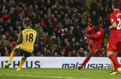 Liverpool's Sadio Mane, centre, shoots and scores his sides 2nd goal of the game during the English Premier League soccer match between Liverpool and Arsenal at Anfield, in Liverpool, England, Saturday, March 4, 2017. Liverpool won the game 3-1. (AP Photo/Dave Thompson)