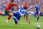 Georgios Seitaridis of Greece (2 in blue) is fouled by Cristiano Ronaldo of Portugal, left, during their Euro 2004, Group A, soccer match at the Dragao stadium in Porto, Portugal, Saturday June 12, 2004. Other teams in group A are Spain and Russia. Greece scored the ensuing penalty kick. (AP Photo/Dusan Vranic)