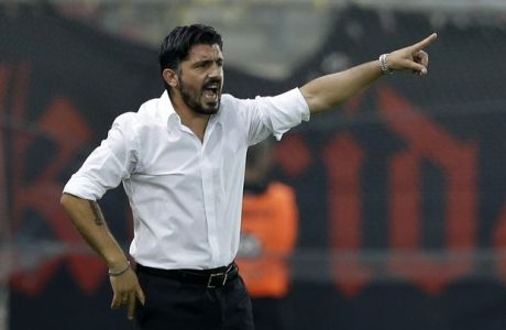 OFI's coach Gennaro Gattuso of Italy gives instructions to his players during a Greek Soccer League match at the Georgios Karaiskakis stadium against Olympiacos in the port of Piraeus, near Athens on Saturday, Sept. 13, 2014. (AP Photo/Thanassis Stavrakis)
