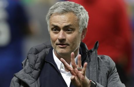 Manchester manager Jose Mourinho shows four fingers after winning 2-0 during the soccer Europa League final between Ajax Amsterdam and Manchester United at the Friends Arena in Stockholm, Sweden, Wednesday, May 24, 2017. (AP Photo/Michael Sohn)