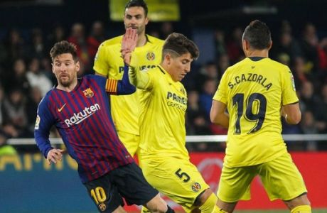April 2, 2019 - Villarreal, Castellon, Spain - Messi of Barcelona and Caseres of Villarreal in action during La Liga Spanish championship, , football match between Villarreal and Barcelona , April 01th, in La Ceramica Stadium in Villarreal, Castellon Spain. Soccer: La Liga - Villarreal v FC Barcelona Barca PUBLICATIONxINxGERxSUIxAUTxONLY - ZUMAa181 20190402_zaa_a181_155 Copyright: xAFP7x