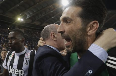 FILE - In this Sunday, May 13, 2018 file photo, Juventus goalkeeper Gianluigi Buffon, right, celebrates its team's seventh straight title, at the end of the Serie A soccer match between Roma and Juventus, at the Rome Olympic stadium. Italy and Juventus captain Gianluigi Buffon will hold a news conference on Thursday when the goalkeeper is expected to announce his retirement. Juventus released details of the conference to be held at Allianz Stadium, on Monday. (AP Photo/Gregorio Borgia, File)