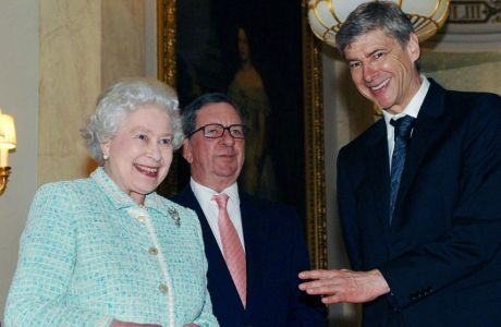 Britain's Queen Elizabeth II meets Arsene Wenger, right, the manager of the English Premier League soccer team Arsenal and the clubs chairman Peter Hill-Wood, center, at Buckingham Palace, London, Thursday Feb. 15, 2007. The Queen finally met Arsenal team members for tea today - four months after she was forced to take time out due to injury. The 80-year-old monarch cancelled a trip to see the club's new Emirates Stadium in October after suffering from a bad back.  (AP Photo/Fiona Hanson/pool)