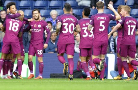 Manchester City's Leroy Sane, left, celebrates with teammates after scoring his side's first goal, during the English Premier League soccer match between West Bromwich Albion and Manchester City, at the Hawthorns in West Bromwich, England, Saturday, Oct. 28, 2017. (AP Photo/Rui Vieira)