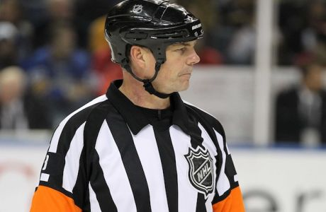 Dec 2, 2011; Buffalo, NY, USA;  NHL referee Mike Leggo (3) during a game between the Detroit Red Wings and Buffalo Sabres at the First Niagara Center.  Mandatory Credit: Timothy T. Ludwig-USA TODAY Sports