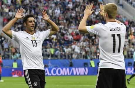 Germany's Lars Stindl, left, celebrates after scoring the opening goal with his teammate Timo Werner during the Confederations Cup final soccer match between Chile and Germany, at the St.Petersburg Stadium, Russia, Sunday July 2, 2017. (AP Photo/Martin Meissner)