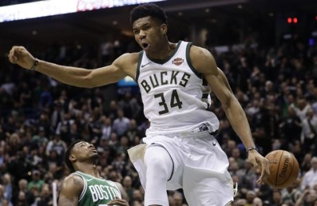 Milwaukee Bucks' Giannis Antetokounmpo reacts after a dunk during the first half of Game 6 of an NBA basketball first-round playoff series against the Boston Celtics Thursday, April 26, 2018, in Milwaukee. (AP Photo/Morry Gash)