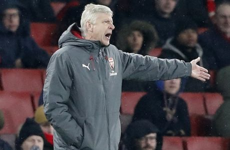 Arsenal manager Arsene Wenger gestures during the English Premier League soccer match between Arsenal and Manchester City at the Emirates stadium in London, Thursday, March 1, 2018.(AP Photo/Frank Augstein)