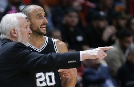 San Antonio Spurs head coach Gregg Popovich talks with guard Manu Ginobili (20) during the second half of an NBA basketball game against the Miami Heat, Wednesday, Oct. 25, 2017, in Miami. The Spurs defeated the Heat 117-100. (AP Photo/Wilfredo Lee)
