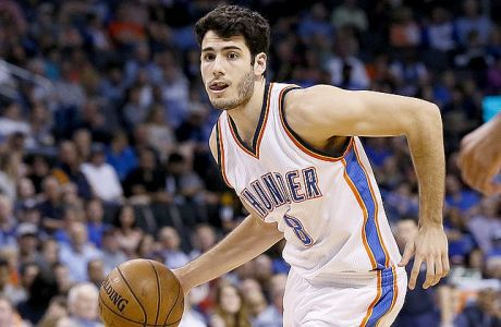 Oklahoma City Thunder guard Alex Abrines (8) drives in the fourth quarter of an NBA basketball game against the Denver Nuggets in Oklahoma City, Wednesday, April 12, 2017. Denver won 111-105. (AP Photo/Sue Ogrocki)