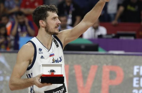 Slovenia's Goran Dragic poses with the most valuable player trophy after defeating Serbia in the Eurobasket European Basketball Championship final match in Istanbul, Sunday, Sept. 17. 2017. (AP Photo/Thanassis Stavrakis)
