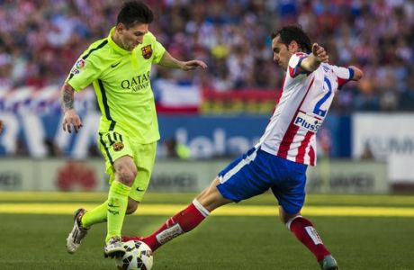 Barcelona's Lionel Messi, left, action with Atletico's Diego Godin, right, during a Spanish La Liga soccer match between Atletico Madrid and FC Barcelona at the Vicente Calderon stadium in Madrid, Spain, Sunday, May 17, 2015. (AP Photo/Andres Kudacki)