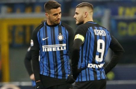 Inter Milan's Mauro Icardi, right, stands with his teammate Matias Vecino after Antonin Barak scored his side's third goal during the Serie A soccer match between Inter Milan and Udinese at the San Siro stadium in Milan, Italy, Saturday, Dec. 16, 2017. (AP Photo/Antonio Calanni)