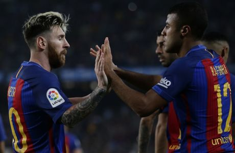 FC Barcelona's Rafinha, right, is congratulated by his teammate Lionel Messi after scored during the Spanish La Liga soccer match between FC Barcelona and Granada at the Camp Nou in Barcelona, Spain, Saturday, Oct. 29, 2016. (AP Photo/Manu Fernandez)
