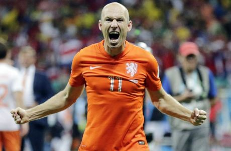 Netherlands' Arjen Robben celebrates after the Netherlands defeated Costa Rica 4-3 in a penalty shootout after a 0-0 tie during the World Cup quarterfinal soccer match at the Arena Fonte Nova in Salvador, Brazil, Saturday, July 5, 2014.(AP Photo/Wong Maye-E)