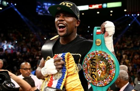 LAS VEGAS, NV - SEPTEMBER 14:  Floyd Mayweather Jr. celebrates his majority decision victory against Canelo Alvarez in their WBC/WBA 154-pound title fight at the MGM Grand Garden Arena on September 14, 2013 in Las Vegas, Nevada.  (Photo by Al Bello/Getty Images)