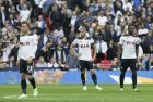 Tottenham's Christian Eriksen, Toby Alderweireld and Moussa Sissoko, from left to right, react after Chelsea scored their second goal during the English FA Cup semifinal soccer match between Chelsea and Tottenham Hotspur at Wembley stadium in London, Saturday, April 22, 2017. (AP Photo/Tim Ireland)