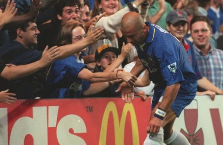 Italian soccer player Gianluca Vialli,  playing for his new English club Chelsea, is welcomed by fans as he collects the ball from the side lines during their match against Middlesbrough at Stamford Bridge, south London, Wednesday August 21, 1996. The final score was 1-0 to Chelsea, with the winning goal scored by Chelsea's other new signing Roberto Di Matteo. (AP Photo/Max Nash)