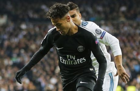 PSG's Neymar, runs with the ball during the Champions League soccer match, round of 16, 1st leg between Real Madrid and Paris Saint Germain at the Santiago Bernabeu stadium in Madrid, Spain, Wednesday, Feb. 14, 2018. (AP Photo/Paul White)