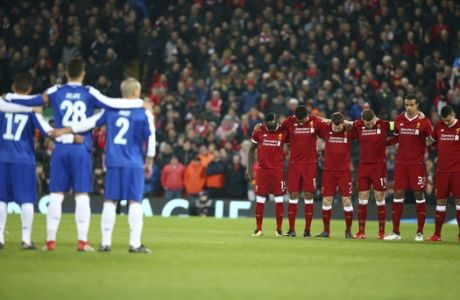 Porto, left, and Liverpool players stand, during a minute of silence for Fiorentina player Davide Astori who died Sunday, before the Champions League round of 16, second leg, soccer match between Liverpool and FC Porto at Anfield Stadium, Liverpool, England, Tuesday March 6, 2018. (AP Photo/Dave Thompson)