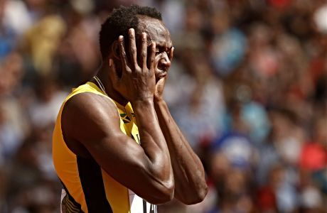 Ο Τζαμαϊκανός Γιουσέιν Μπολτ πριν από τον τελικό της σκυταλοδρομίας 4x100μ. στο Παγκόσμιο ανοιχτού στίβου στο Λονδίνο, το 2017