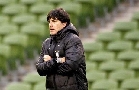 Germany manager Joachim Löw watching his side during a training session  at the Aviva Stadium, Dublin, Ireland, Thursday, Oct. 11, 2012.  The German team were training ahead of their Group C world Cup 2014 qualifying mtach against the Republic of Ireland on Friday.  (AP Photo/Peter Morrison)