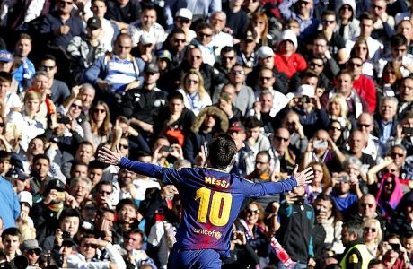 Barcelona's Lionel Messi celebrates after scoring during a Spanish La Liga soccer match between Real Madrid and Barcelona at the Santiago Bernabeu stadium in Madrid, Spain, Saturday, Dec. 23, 2017. (AP Photo/Paul White)