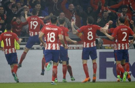 Atletico players celebrate scoring their side's second goal during the Europa League Final soccer match between Marseille and Atletico Madrid at the Stade de Lyon in Decines, outside Lyon, France, Wednesday, May 16, 2018. (AP Photo/Francois Mori)