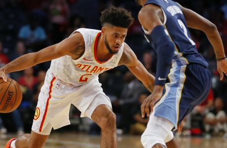Atlanta Hawks guard Tyler Dorsey (2) looks to get around Memphis Grizzlies guard Kobi Simmons (2) in the second half of an NBA preseason basketball game on Monday, Oct. 9, 2017, in Atlanta. (AP Photo/Todd Kirkland)