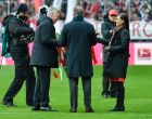 Bayern Munich's Italian head coach Carlo Ancelotti (2ndL) gets flowers from Bayern Munich's chief executive officer Karl Heinz Rummenigge prior the German first division Bundesliga football match between Bayern Munich and Hamburger SV in Munich, southern Germany, on February 25, 2017. / AFP / Guenter SCHIFFMANN / RESTRICTIONS: DURING MATCH TIME: DFL RULES TO LIMIT THE ONLINE USAGE TO 15 PICTURES PER MATCH AND FORBID IMAGE SEQUENCES TO SIMULATE VIDEO. == RESTRICTED TO EDITORIAL USE == FOR FURTHER QUERIES PLEASE CONTACT DFL DIRECTLY AT + 49 69 650050         (Photo credit should read GUENTER SCHIFFMANN/AFP/Getty Images)