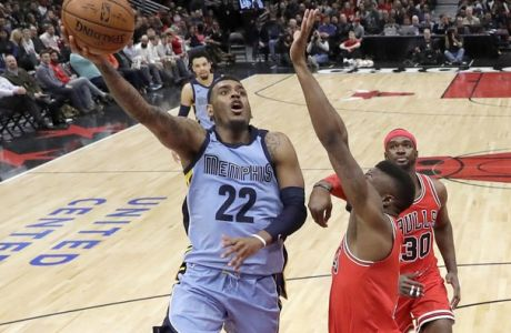 Memphis Grizzlies' Xavier Rathan-Mayes (22) shoots over Chicago Bulls' David Nwaba during the second half of an NBA basketball game Wednesday, March 7, 2018, in Chicago. The Bulls won 119-110. (AP Photo/Charles Rex Arbogast)
