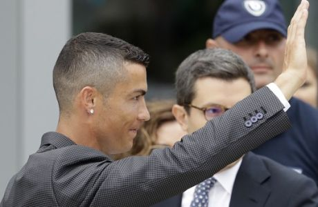 Portuguese ace Ronaldo salutes his fans as he arrives to undergo medical checks at the Juventus stadium in Turin, Italy, Monday, July 16, 2018. (AP Photo/Luca Bruno)