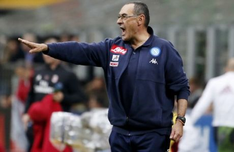 Napoli coach Maurizio Sarri gives instructions during the Serie A soccer match between AC Milan and Napoli at the San Siro stadium in Milan, Italy, Sunday, April 15, 2018. (AP Photo/Antonio Calanni)