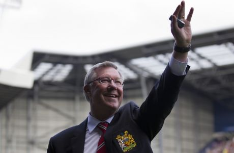 Manchester United manager Sir Alex Ferguson waves to supporters before his last game in charge of his team, their English Premier League soccer match away at West Bromwich Albion at The Hawthorns Stadium, West Bromwich, England, Sunday May. 19, 2013. (AP Photo/Jon Super)